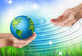 Hands holding globe. Environmental energy concept. — Stock Photo