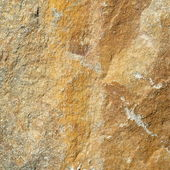 Texture of yellow stone,stone wall background — Stok fotoğraf