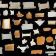 Set paper scraps,cardboard, newspaper and masking tape isolated on black — Stock Photo #5425764
