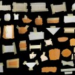 Set paper scraps,cardboard, newspaper and masking tape isolated on black — Stock Photo
