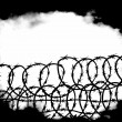War scenes with barbed wire fence and black fog background — Stok fotoğraf