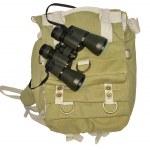 Binoculars and backpack isolated on white background — Stock Photo