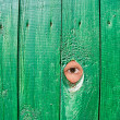 Eye in a hole in fence — Stock Photo