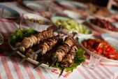 Shashlik on the table — Stock Photo