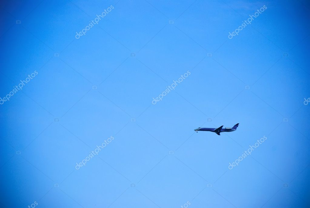 Plane in the blue cloudless sky — Stock Photo #6318140