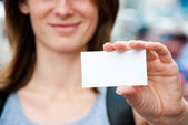 Woman holding empty card — Stock Photo
