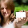 Woman holding empty card — Stock Photo #6440343