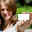 Woman holding empty card — Stock Photo #6440350