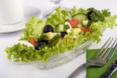 Salad with fresh lettuce leaves, tomato, cucumber, egg, olives, pepper, sp — Stock Photo