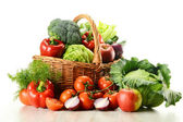 Vegetables in wicker basket — Stok fotoğraf