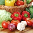 Composition with raw vegetables and wicker basket — Stock Photo #5408025