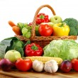 Composition with raw vegetables and wicker basket - Stok fotoğraf