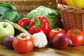 Composition with raw vegetables and wicker basket — Stock Photo