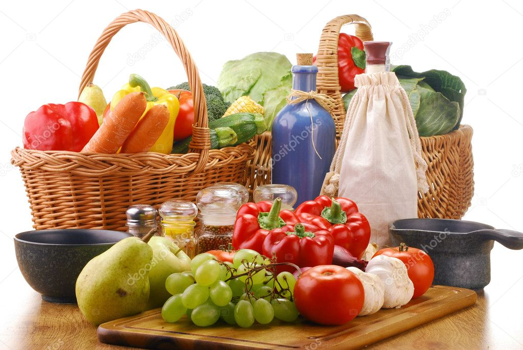 Composition with raw vegetables and wicker basket — Stock Photo #5408149
