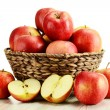 Apples and wicker basket isolated on white - Stock Photo