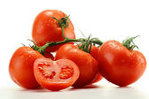 Composition with fresh tomatoes isolated on white — Stock Photo