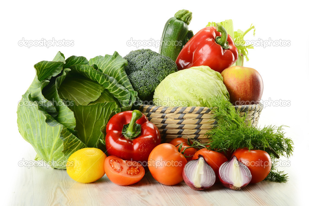 Composition with raw vegetables and wicker basket isolated on white — Stock Photo #5569993