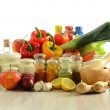 Spices and vegetables on kitchen table - Foto Stock