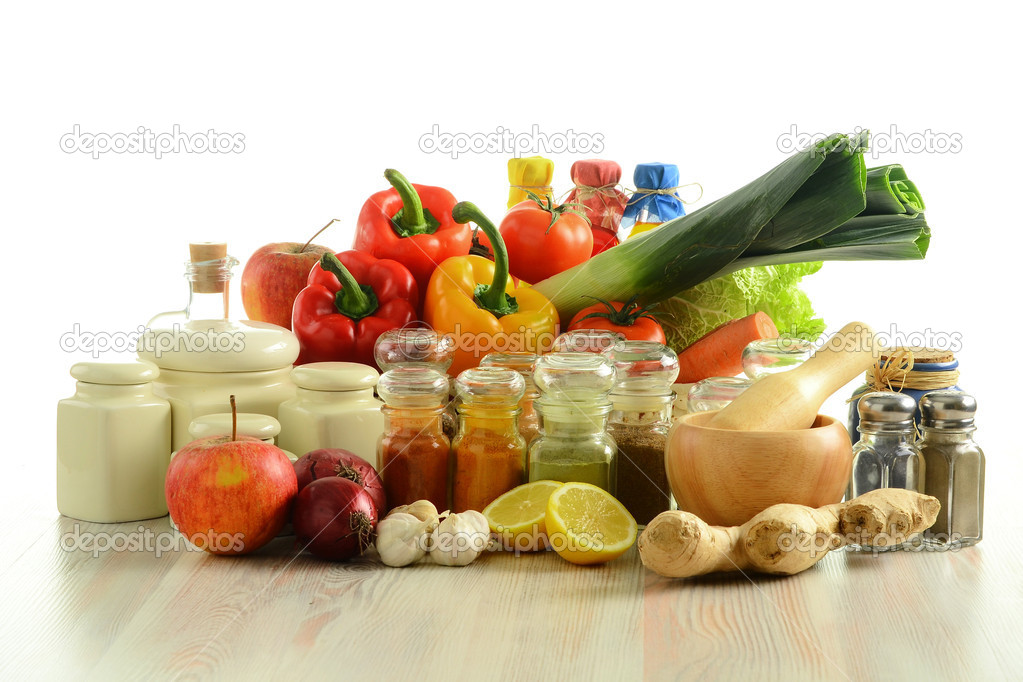 Composition Of 4 Kitchen Utensils : Spices and vegetables on kitchen table — Stock Photo © monticello ...
