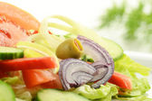 Composition with vegetable salad with olives — Stock Photo