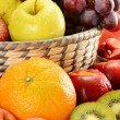 Fruits and wicker basket — Stock Photo #5849596