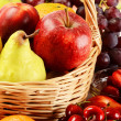Fruits and wicker basket — Stock Photo #5849614