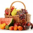 Fruits and wicker basket — Stock Photo