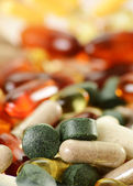 Composition with dietary supplement capsules and tablets. Spirul — Stock Photo