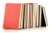 Composição com pilha de livros isolado no branco — Fotografia Stock