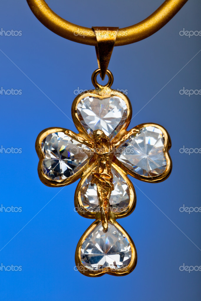 Pendant of a crucifix with five zirconia enchased — Stock Photo #5793875