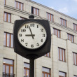 Street Clock in Front of a Building — Stock Photo