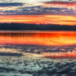 Panorama of a sunrise on a lake — Stock Photo #5442810