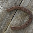 Old rusty horse shoe - Stock Photo