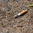 Royalty-Free Stock Photo: Smoked cigarette on a ground