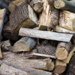 Pile of uncut firewood — Stock Photo