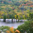 The River and parked boats during the autumn season. - Stock Photo