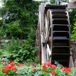 Waterwheel in a Flower Garden - Stock Photo