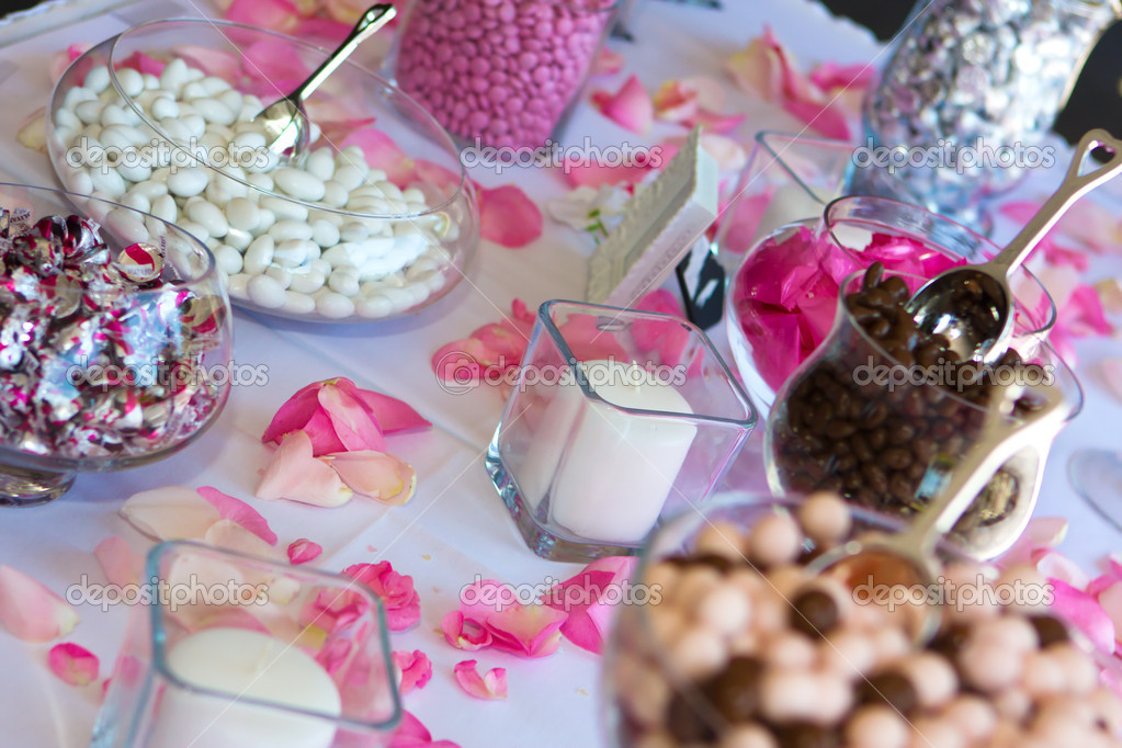 Colorful Wedding Candy Table with all the chocolate goodies on display. — Stock Photo #5445529