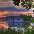 Panorama of a sunrise on a lake — Stock Photo