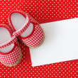 Baby shoes and blank note - Stock Photo