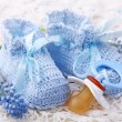 Handmade blue baby booties - Stock Photo