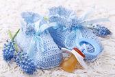 Handmade blue baby booties — Stock Photo