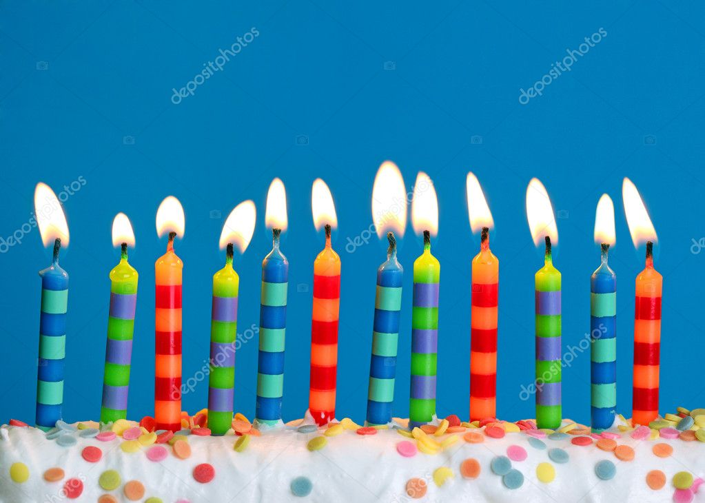 Birthday candles on blue background  Stock Photo #5445343