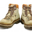 Old scuffed hiking boots - Stock Photo