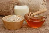 Oatmeal, milk and honey spa — Stock Photo
