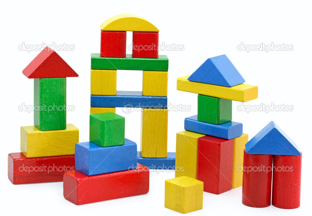 Wooden building blocks on white background  Stock Photo #5524734