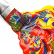 Paintbrush and mixed acrylic paint - Foto Stock