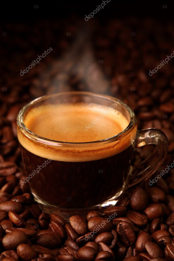 Espresso on coffee beans — Stockfoto #6028012