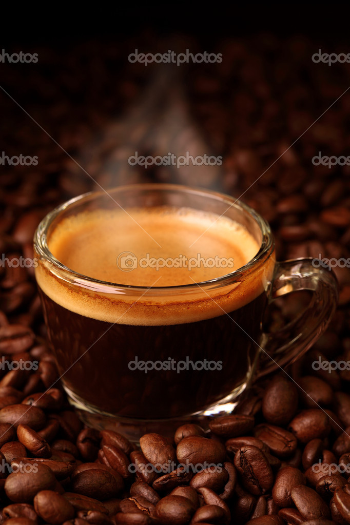 Espresso on coffee beans — Foto de Stock   #6028012