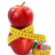 Two red apples and tape measure — Stok fotoğraf